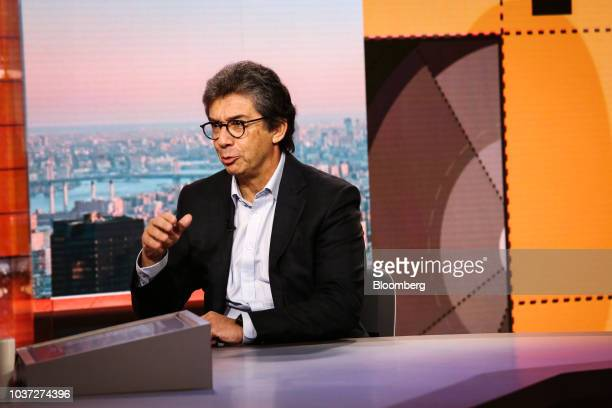 Andre Calantzopoulos chief executive officer of Philip Morris International Inc listens during a Bloomberg Television interview in New York US on...