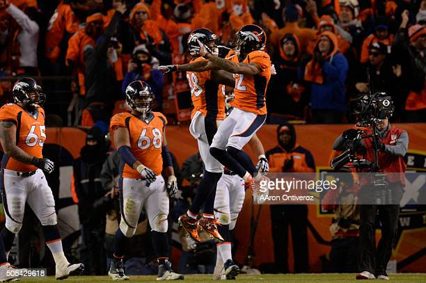 Andre Caldwell of the Denver Broncos and Demaryius Thomas of the Denver Broncos celebrate a 2point conversion in the fourth quarter The Denver...
