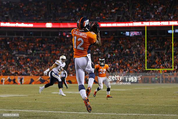 Andre Caldwell of the Denver Broncos catches a first quarter touchdown pass against the San Diego Chargers at Sports Authority Field at Mile High on...