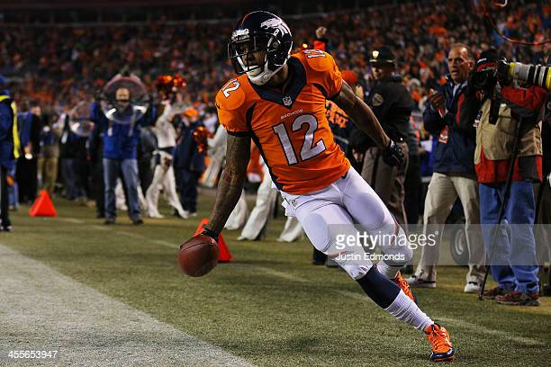 Andre Caldwell of the Denver Broncos celebrates his first quarter touchdown against the San Diego Chargers at Sports Authority Field at Mile High on...