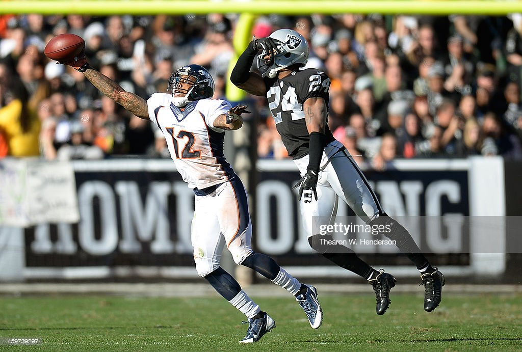 Andre Caldwell #12 of the Denver Broncos is unable to come up with this pass, defended by Charles Woodson #24 of the Oakland Raiders during the first quarter at O.co Coliseum on December 29, 2013 in Oakland, California. The Broncos won the game 34-14.