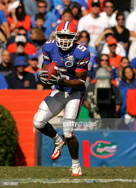 Andre Caldwell of the Florida Gators runs for yardage during a game against the FAU Owls at Ben Hill Griffin Stadium on November 17 2007 in...