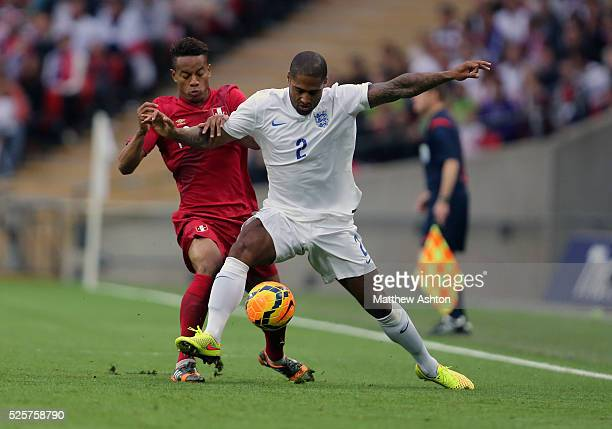 Andre Carillo of Peru and Glen Johnson of England