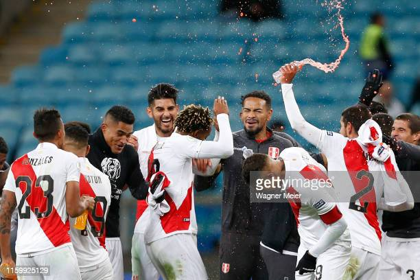 Andre Carrillo and Paolo Guerrero of Peru celebrate with teammates after winning the Copa America Brazil 2019 Semi Final match between Chile and Peru...