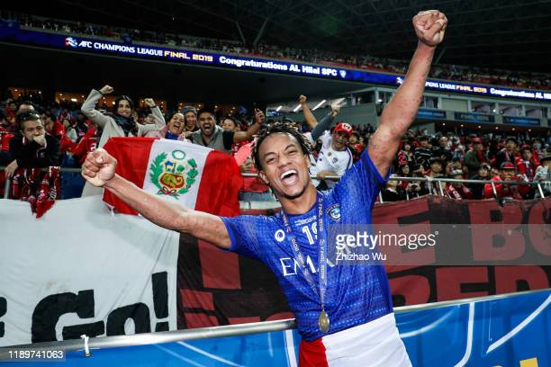 Andre Carrillo Diaz of Al Hilal celebrates the champion with fans after the AFC Champions League Final second leg match between Urawa Red Diamonds...