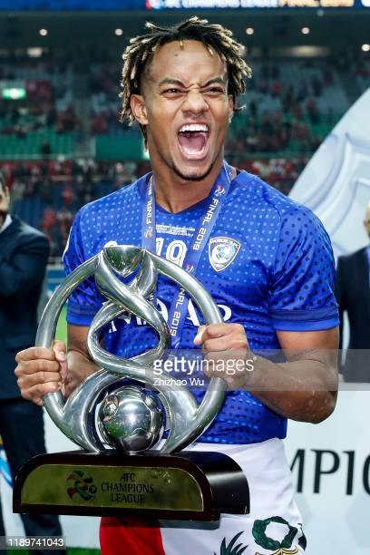 Andre Carrillo Diaz of Al Hilal celebrates the champion with the trophy after the AFC Champions League Final second leg match between Urawa Red...