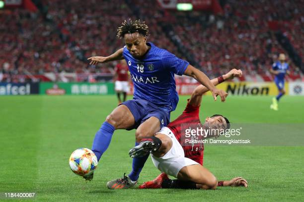 Andre Carrillo of Al Hilal is tackled by Tomoaki Makino of Urawa Red Diamonds during the AFC Champions League Final second leg match between Urawa...