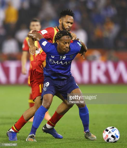 Andre Carrillo of Al Hilal SFC holds off Fousseny Coulibaly of Esperance Sportive de Tunis during the FIFA Club World Cup 2nd round match between Al...