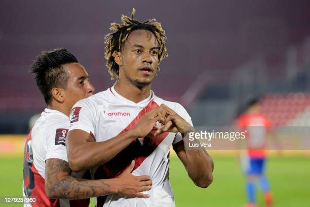 Andre Carrillo of Peru celebrates after scoring the first goal of his team during a match between Paraguay and Peru as part of South American...