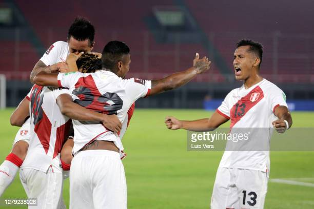 Andre Carrillo of Peru celebrates with teammates after scoring the first goal of their team during a match between Paraguay and Peru as part of South...