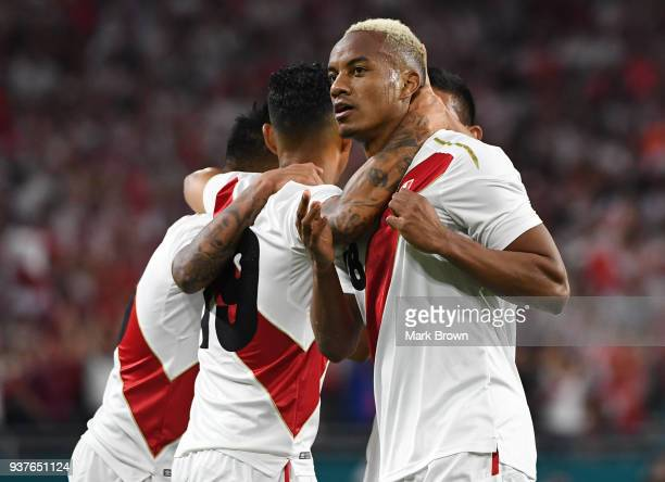Andre Carrillo of Peru celebrates with teammates after scoring the first goal of his team during the international friendly match between Peru and...