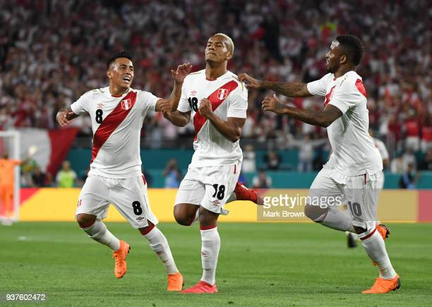 Andre Carrillo of Peru celebrates with teammates Christian Cueva and Jefferson Farfan after scoring the first goal of his team during the...