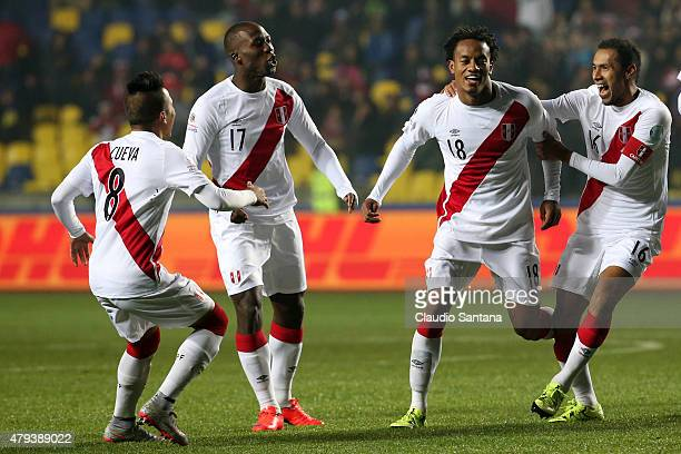 Andre Carrillo of Peru celebrates with teammates Christian Cueva, Luis Advincula, and Carlos Lobaton after scoring the opening goal during the 2015...