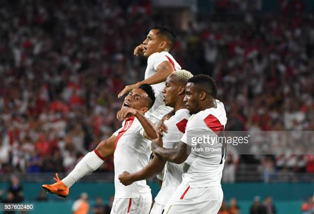 Andre Carrillo of Peru celebrates with teammates Christian Cueva Jefferson Farfan and Yoshimar Yotun after scoring the first goal of his team during...
