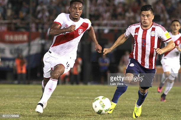 Andre Carrillo of Peru chases Jorge Moreira of Paraguay during a match between Paraguay and Peru as part of FIFA 2018 World Cup Qualifiers at...