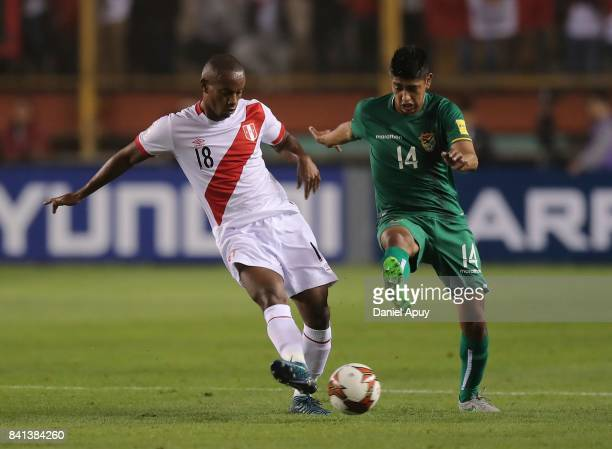 Andre Carrillo of Peru fights for the ball with Raul Castro of Bolivia during a match between Peru and Bolivia as part of FIFA 2018 World Cup...