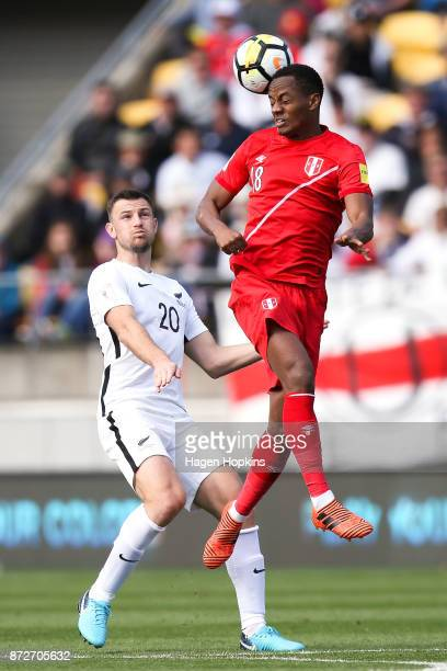 Andre Carrillo of Peru heads the ball under pressure from Tommy Smith of New Zealand during the 2018 FIFA World Cup Qualifier match between the New...