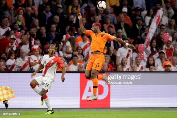 Andre Carrillo of Peru Ryan Babel of Holland during the International Friendly match between Holland v Peru at the Johan Cruijff Arena on September 6...