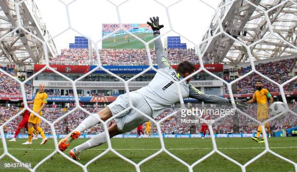 Andre Carrillo of Peru scores his team's first goal past Mathew Ryan of Australia during the 2018 FIFA World Cup Russia group C match between...