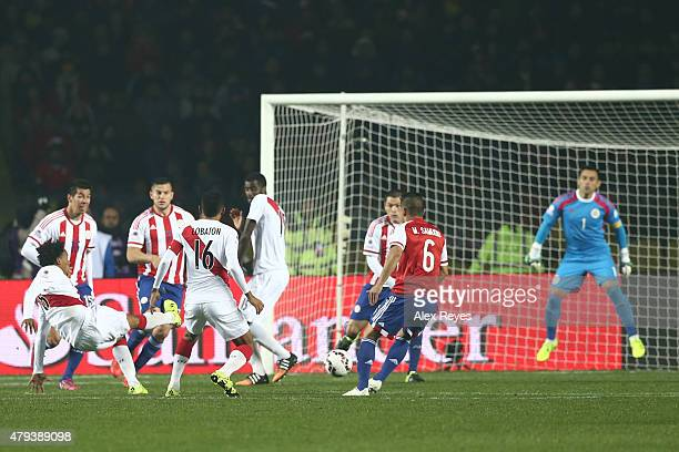 Andre Carrillo of Peru shoots to score the opening goal of his team during the 2015 Copa America Chile Third Place Playoff match between Peru and...