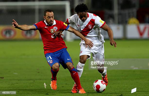 Andre Carrillo of Peru struggles for the ball with Marcelo Diaz of Chile during a match between Peru and Chile as part of FIFA 2018 World Cup...