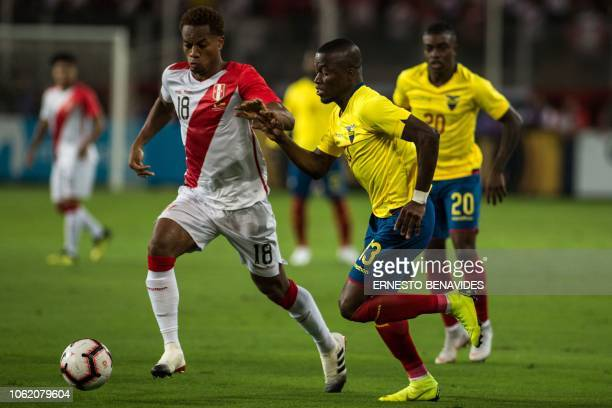 Andre Carrillo of Peru vies for the ball with Enner Valencia of Ecuador during a friendly football match at the National Stadium in Lima on November...