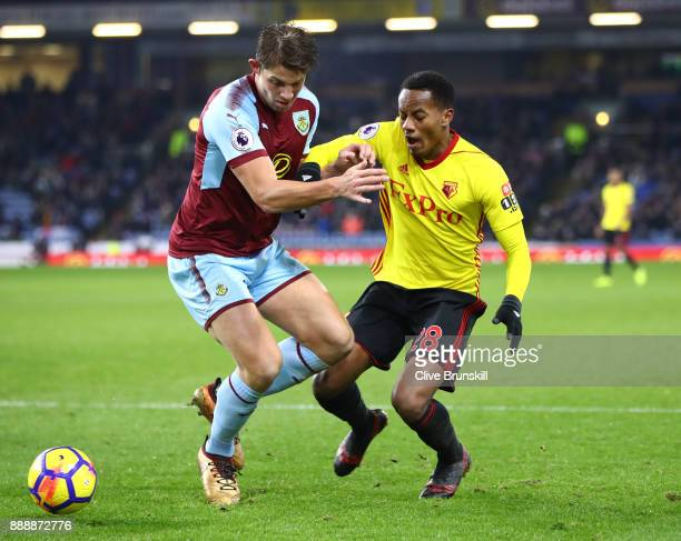 Andre Carrilo of Watford and James Tarkowski of Burnley in action during the Premier League match between Burnley and Watford at Turf Moor on...