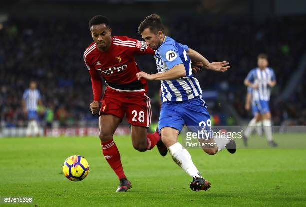 Andre Carrilo of Watford battles for possesion with Markus Suttner of Brighton and Hove Albion during the Premier League match between Brighton and...