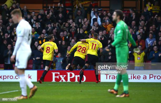 Andre Carrilo of Watford celebrates scoring the opening goal with team mates during the Premier League match between Watford and Swansea City at...