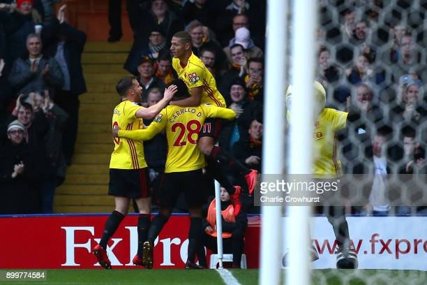 Andre Carrilo of Watford celebrates with teammates after scoring his sides first goal during the Premier League match between Watford and Swansea...