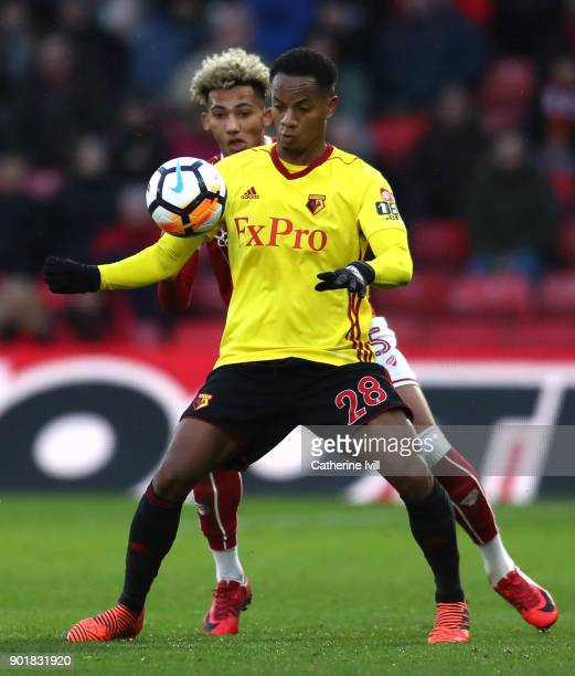 Andre Carrilo of Watford holds off Lloyd Kelly of Bristol City during The Emirates FA Cup Third Round match between Watford and Bristol City at...
