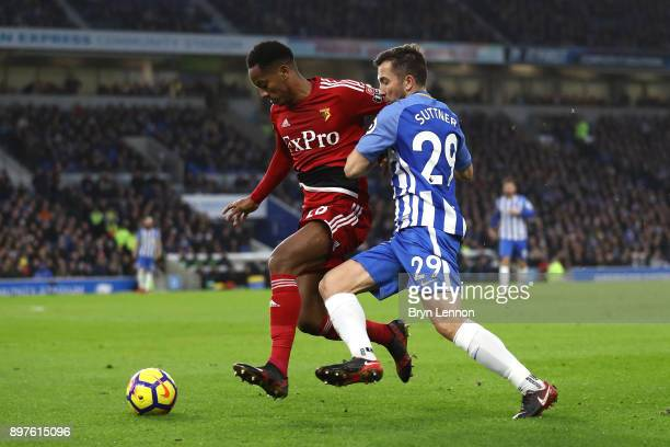 Andre Carrilo of Watford is challenged by Markus Suttner of Brighton and Hove Albion during the Premier League match between Brighton and Hove Albion...