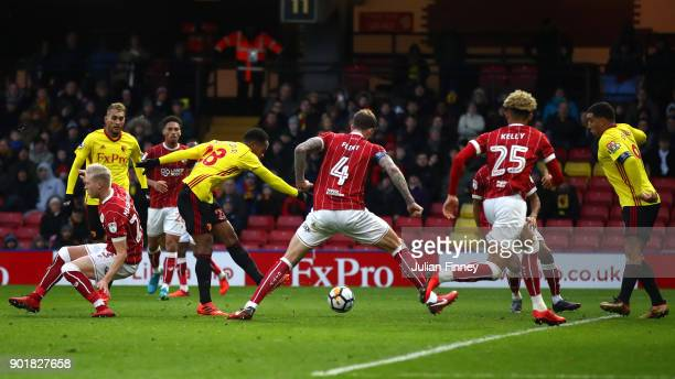 Andre Carrilo of Watford scores his sides first goal during The Emirates FA Cup Third Round match between Watford and Bristol City at Vicarage Road...