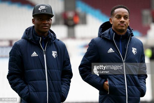 Andre Carrilo of Watford speaks to Didier Ndong of Watford on the pitch prior to the Premier League match between West Ham United and Watford at...