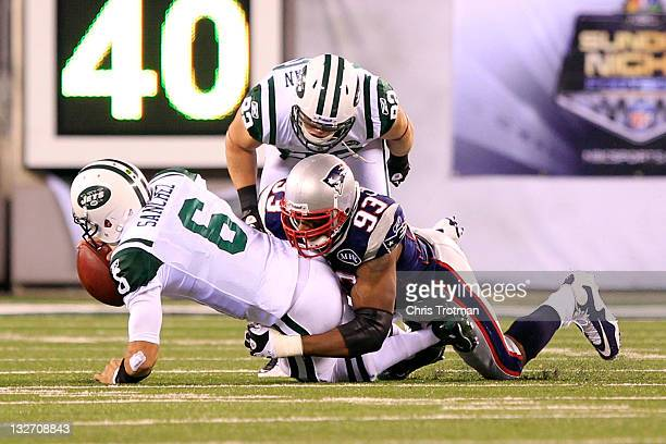 Andre Carter of the New England Patriots sacks Mark Sanchez of the New York Jets at MetLife Stadium on November 13 2011 in East Rutherford New Jersey