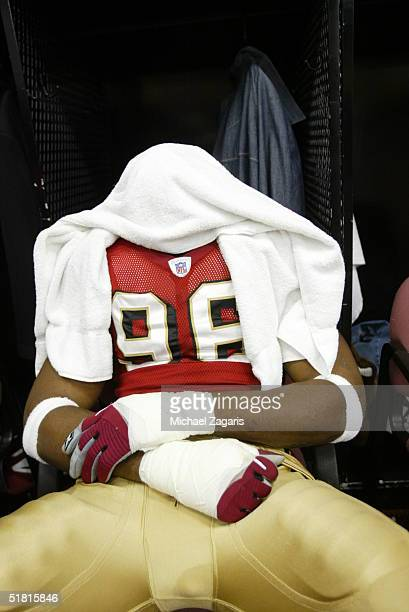 Andre Carter of the San Francisco 49ers prepares in the locker room before the game against the Miami Dolphins at Monster Park on November 28 2004 in...