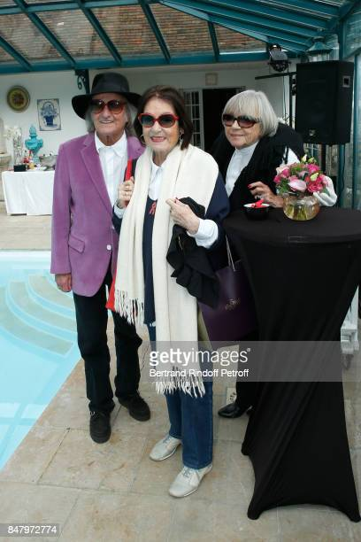 Andre Chapelle Nana Mouskouri and wardrobe Mine BarralVergez attend the Garden Party organized by Bruno Finck companion of JeanClaude Brialy at...