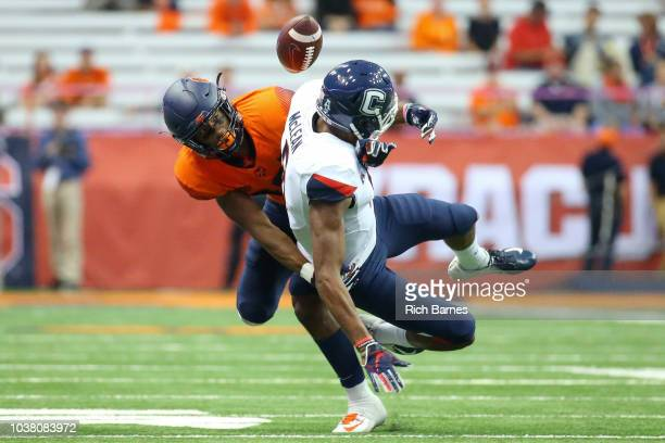 Andre Cisco of the Syracuse Orange breaks up a pass intended for Aaron McLean of the Connecticut Huskies during the fourth quarter at the Carrier...