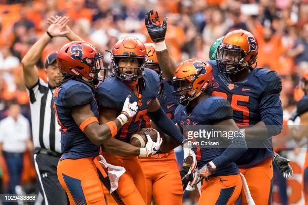 Andre Cisco of the Syracuse Orange celebrates an interception during the first quarter against the Wagner Seahawks at the Carrier Dome on September 8...