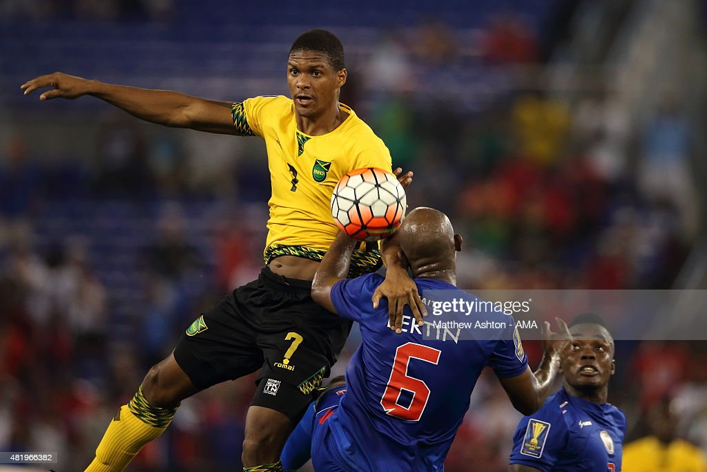Andre Clennon of Jamaica and Frantz Bertin of Haiti during the Gold Cup Quarter Final between Haiti and Jamaica at M&T Bank Stadium on July 18, 2015 in Baltimore, Maryland.