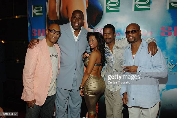 Andre Cleveland Professional basketball player Magic Johnson model Dollicia Bryan Greg Lites and Filipe Darrell pose on the red carpet at Winky...