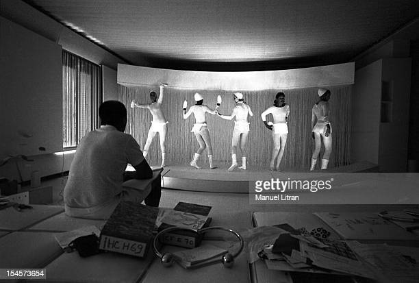 Andre COURREGES back in white shorts sitting on a square cushion in a room of his white ultramodern rooms rue Francois ler has PARIS setting the...