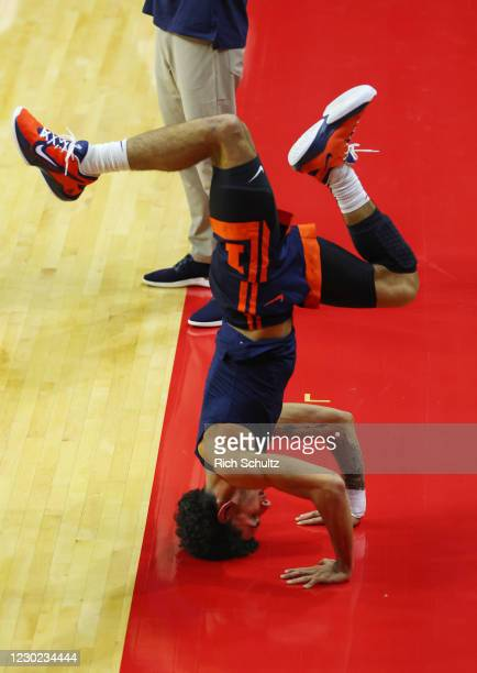 Andre Curbelo of the Illinois Fighting Illini does a hand stand before a college basketball game against the Rutgers Scarlet Knights at Rutgers...
