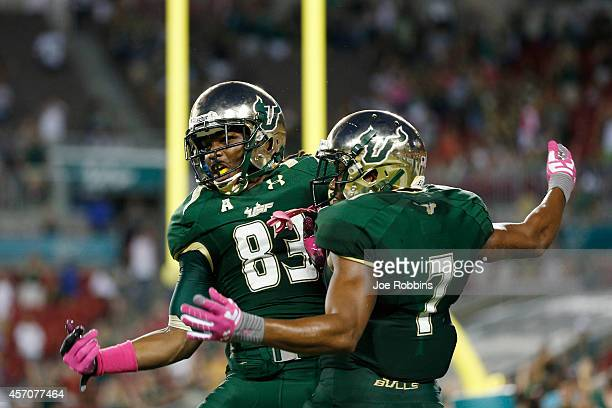 Andre Davis of the South Florida Bulls celebrates with Deonte Welch after making a 51yard touchdown reception in the first half of the game against...