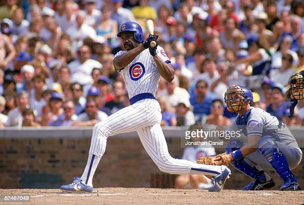 Andre Dawson of the Chicago Cubs follows through on his swing during a game with the Los Angeles Dodgers in 1987 at Wrigley Field in Chicago Illinois