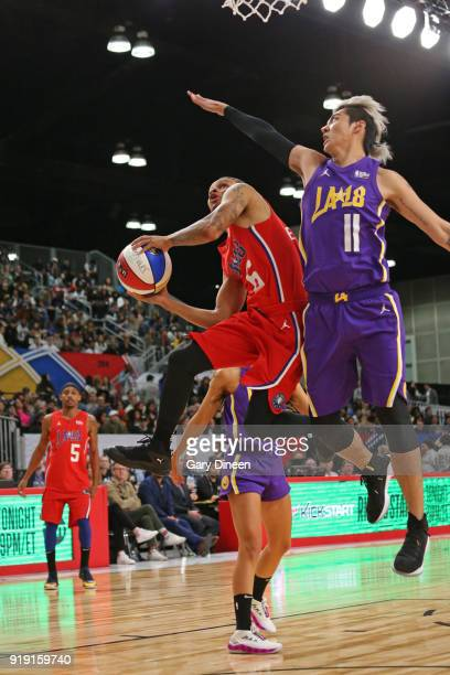 Andre De Grasse drives to the basket around Kris Wu during the NBA AllStar Celebrity Game presented by Ruffles as a part of 2018 NBA AllStar Weekend...