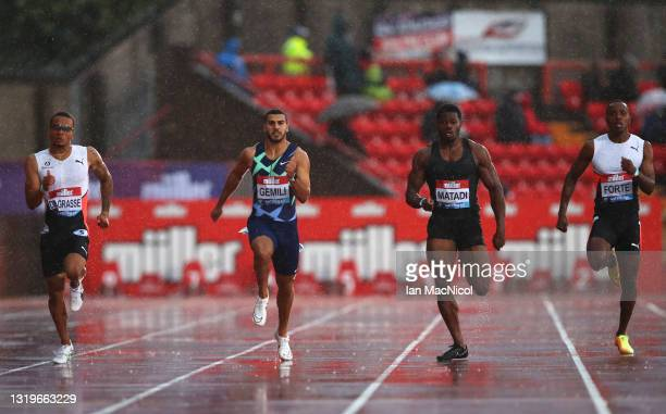 Andre De Grasse of Canada, Adam Gemili of Great Britain, Emmanuel Matadi of Liberia and Julian Forte of Jamaica compete in the Men's 200 metres...