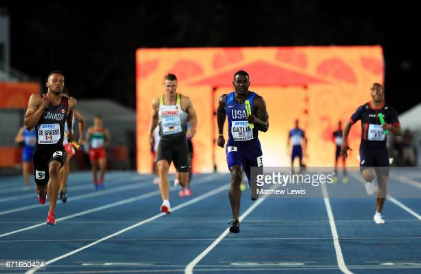 Andre De Grasse of Canada and Justin Gatlin of the USA run to the finishline in heat two of the Men's 4 x 100 Meters Relay during the IAAF/BTC World...