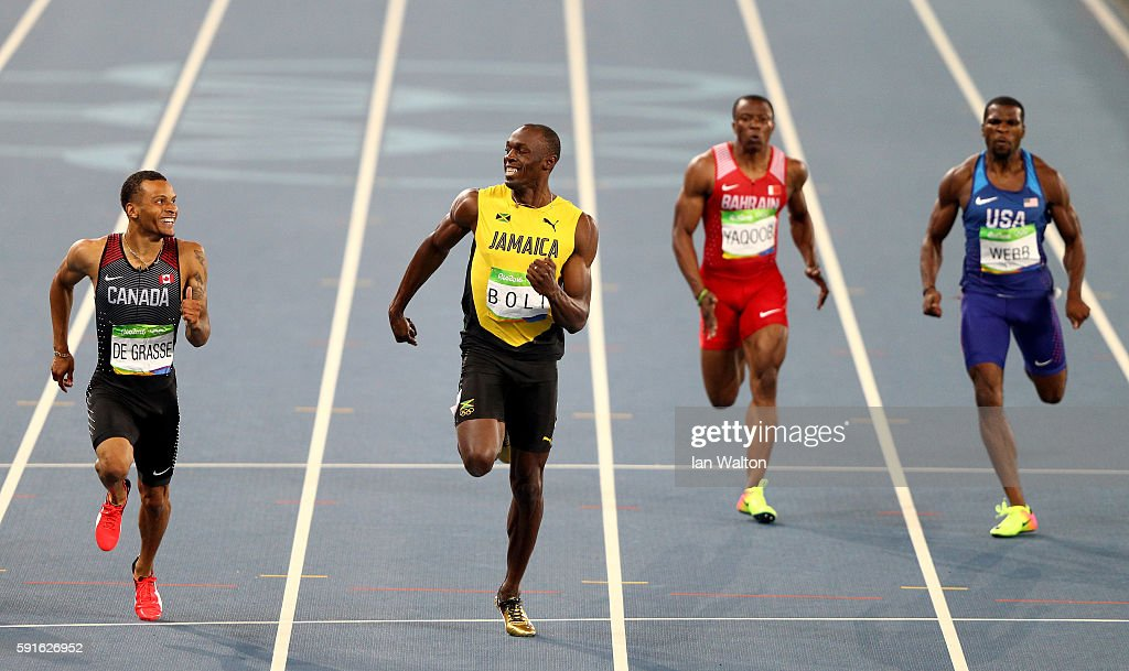 Andre de Grasse of Canada (L) and Usain Bolt of Jamaica (2nd-L) react as they compete in the Men's 200m Semifinals on Day 12 of the Rio 2016 Olympic Games at the Olympic Stadium on August 17, 2016 in Rio de Janeiro, Brazil.
