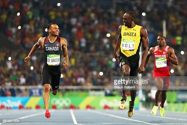 Andre De Grasse Of Canada And Usain Bolt Jamaica React As They Compete In The